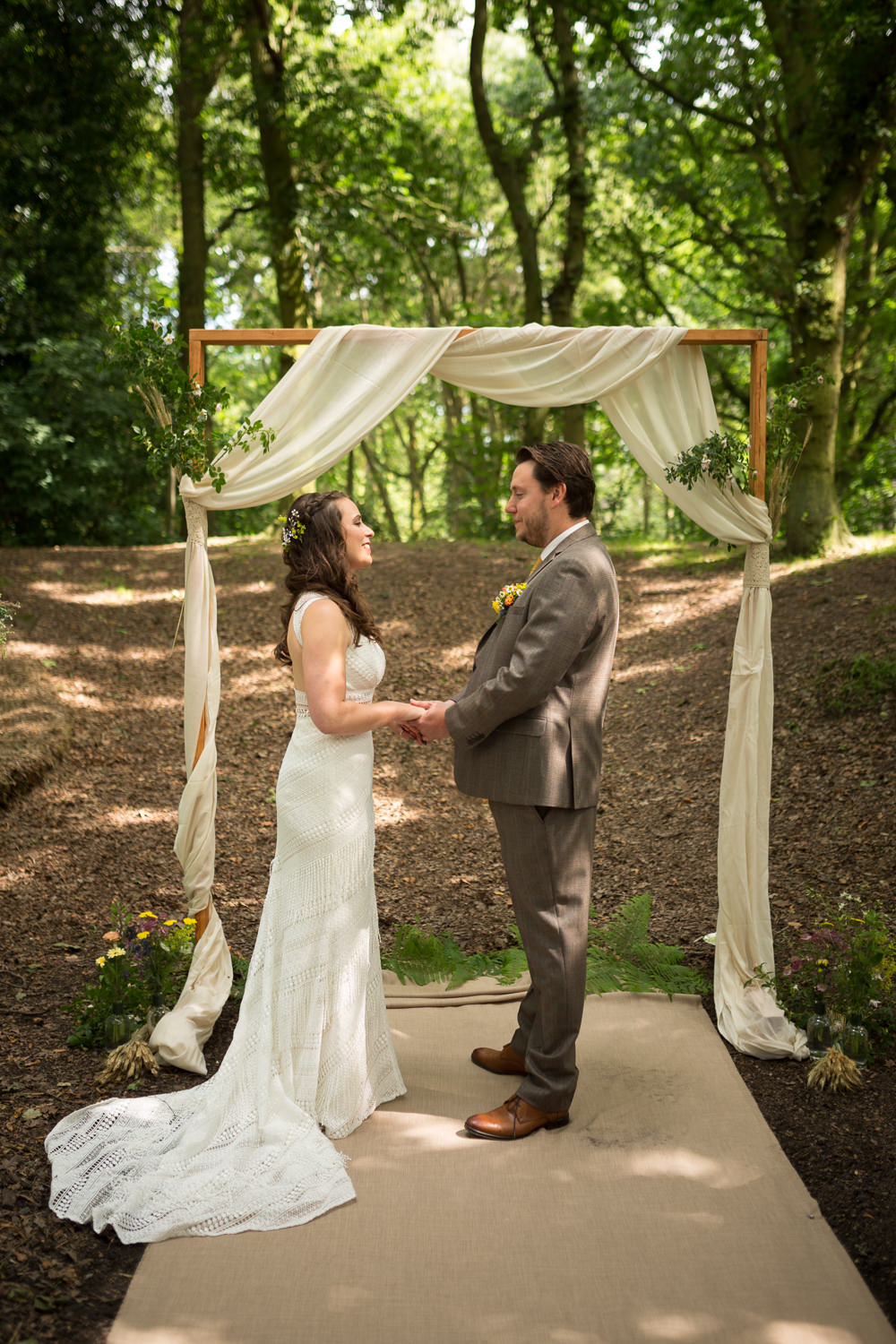 bride and groom holding hands during outdoor sherwood forest wedding