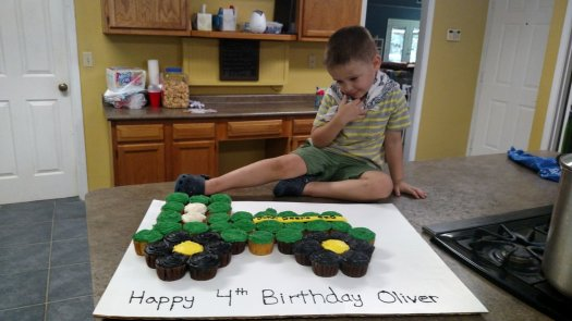 Oliver with his tractor cake