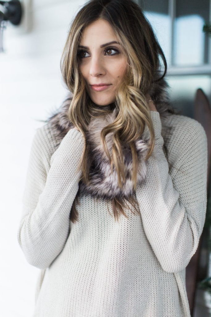 Lace trim sweater with boyfriend jeans and a faux fur scarf, winter style