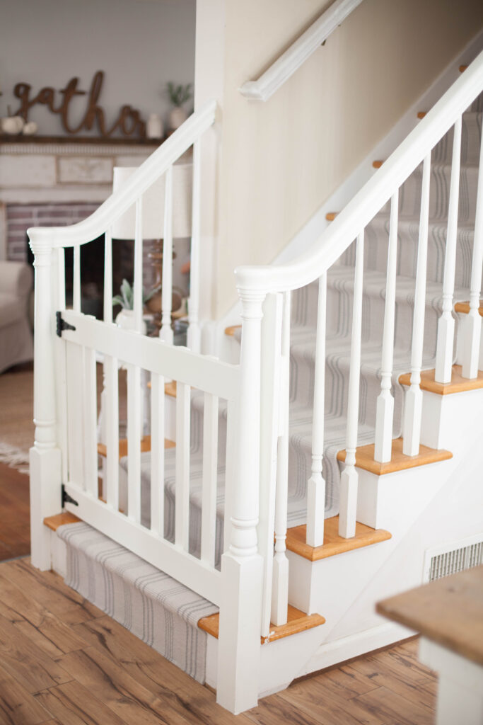 A Simple Guide To Making A DIY Stair Runner Using Area Rugs And Carpet Tape  For