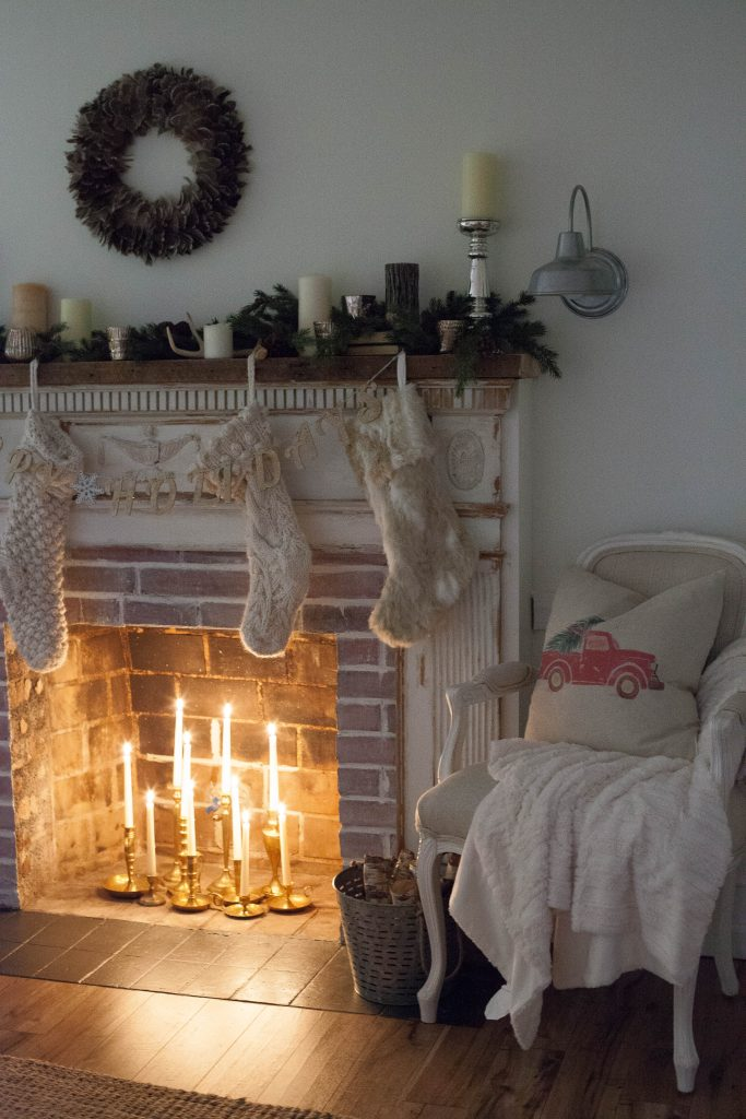 A simple and rustic farmhouse Christmas living room featuring a mixture of textures and vintage finds!