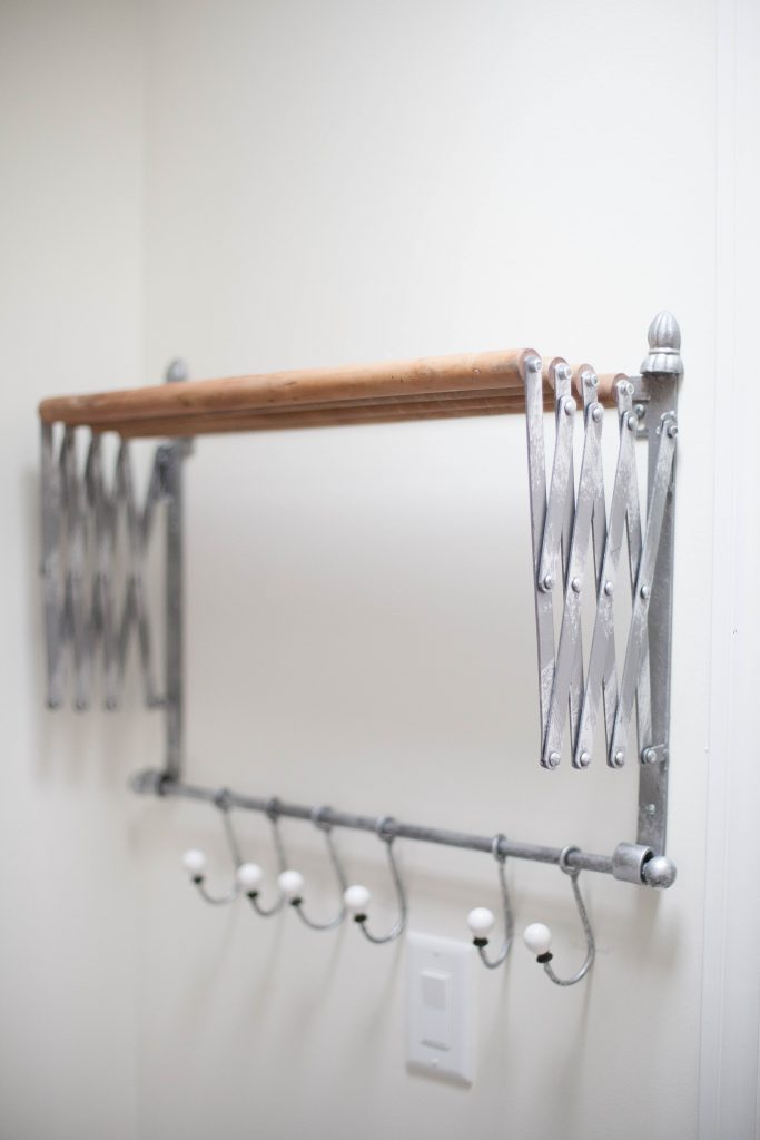 This accordion wall drying rack is fun and functional for your farmhouse laundry room!