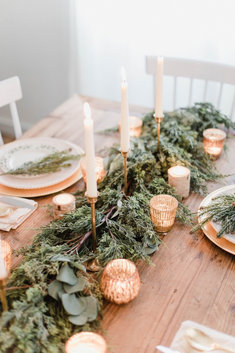Connecticut life and style blogger Lauren McBride shares a white and gold Christmas tablescape featuring a mix of faux greenery, metallics, and antique touches.