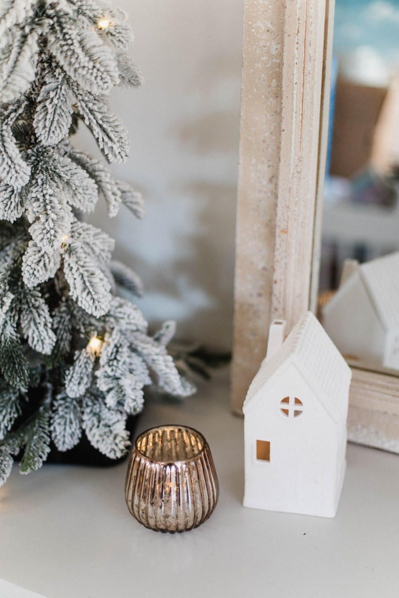 Connecticut life and style blogger Lauren McBride blog shares her Holiday Sideboard Decor, featuring a simplistic, neutral set up for the holidays.