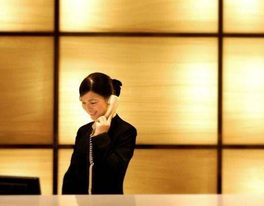 Le personnel en ambassadeur de franchises hôtelières