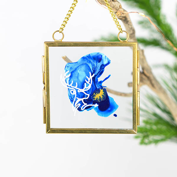Glass ornament with deer