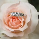 A ring with a pink rose