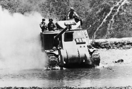 The War In The Far East: The Burma Campaign 1941-1945, The Battle of Imphal-Kohima March - July 1944: An M3 Lee tank crosses a river north of Imphal to meet the Japanese advance, March 1944. (Photo by No 9 Army Film & Photographic Unit/ Imperial War Museums via Getty Images)