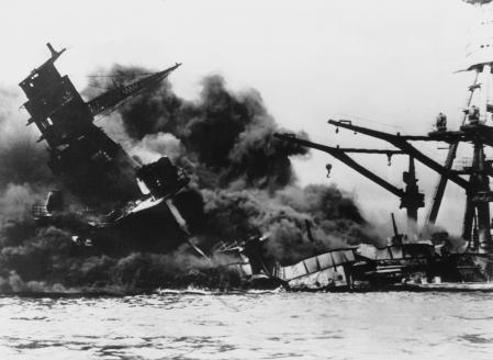 UNITED STATES - JANUARY 01:  The cuirassier ARIZONA burning and sinking after having exploded in the wake of the Japanese bombing of the American naval base at Pearl Harbor. This bombing led the United States to enter World War II.  (Photo by Keystone-France/Gamma-Keystone via Getty Images)