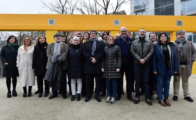 Diputados de JuntsxCat en Bruselas. / AFP PHOTO / JOHN THYS