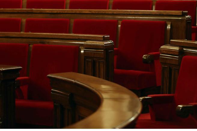 Vista del escaño ocupado en la pasad legislatura por el presidente de la Generalitat en el hemiciclo del Parlament