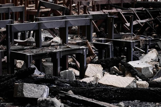 A picture shows damaged chairs and rubble in the Notre Dame de Paris Cathedral one month after the event major fire damage on May 15, 2019, in Paris. - The April 15, fire destroyed the roof and steeple of the 850-year-old Gothic cathedral. Images of the ancient cathedral going up in flames sparked shock and dismay across the globe as well as in France, where it is considered one of the nation's most beloved landmarks. (Photo by Philippe LOPEZ / POOL / AFP)