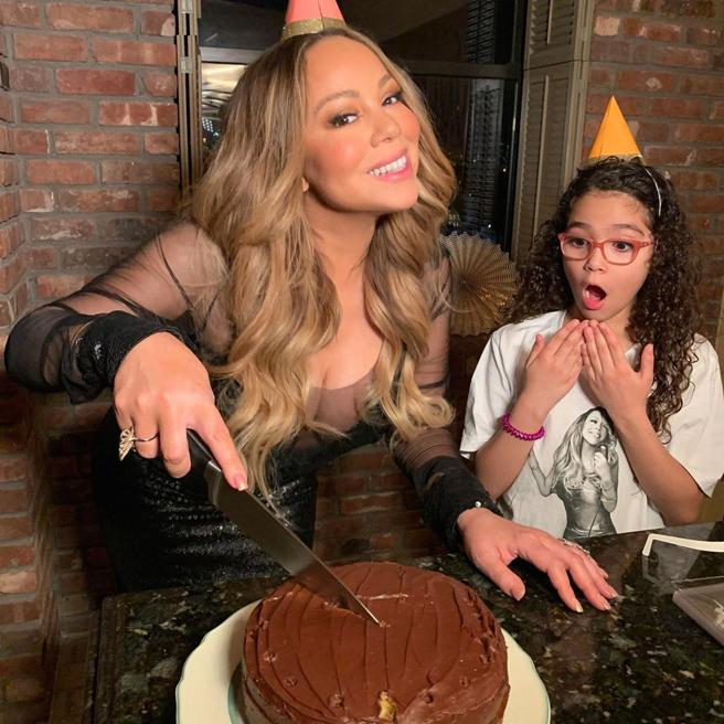Mariah Carey cuts the cake for his 50th birthday along with her daughter Monroe