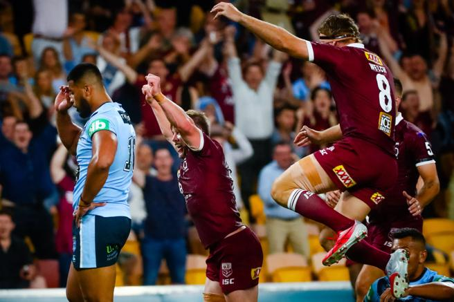 Queensland players celebrate the win