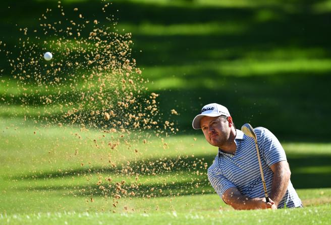 Richard Sterne pulls the ball out of the bunker at the 14th hole at Randpark Golf Club in Johannesburg.