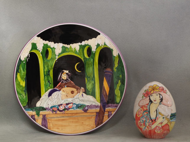 Plate with female musician in the moonlight and egg with woman, faience pottery