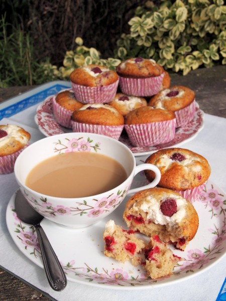 A cuppa with some freshly baked Raspberry Cheesecake Muffins