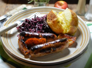 Apple and Sausage Fry with Red Cabbage and Jacket Potato