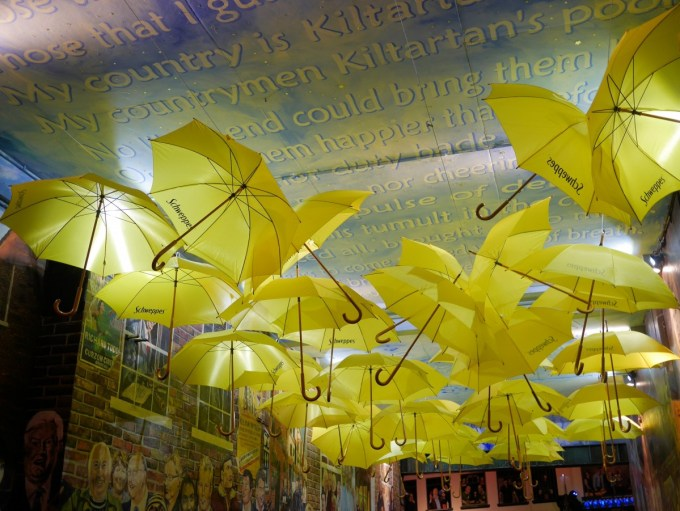 Yellow Umbrellas and Street Art neat The Harp Pub in Belfast