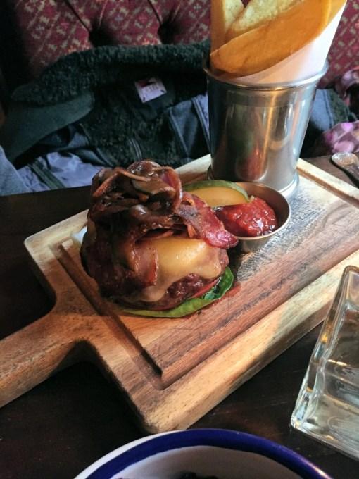 Tavern steak burger, mature cheddar, smoked bacon & caramelised onion jam, brioche bun pickled 'slaw & hand-cut chips