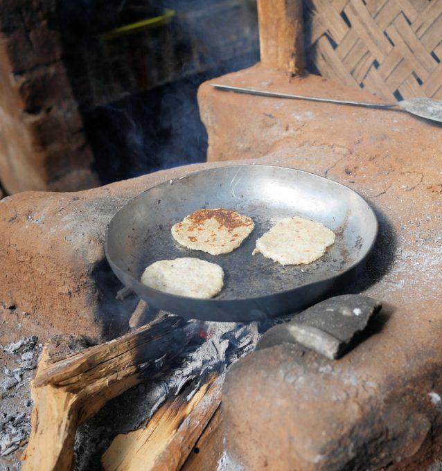 cooking pol roti