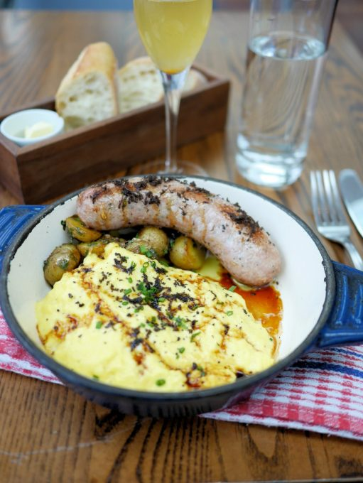 Farmers sausage with truffles, fluffy scrambled eggs with truffle and home style fried potatoes with truffle oil