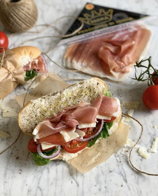 Italian Sub Sandwich with Prosciutto di Parma, Salad, and Cheese
