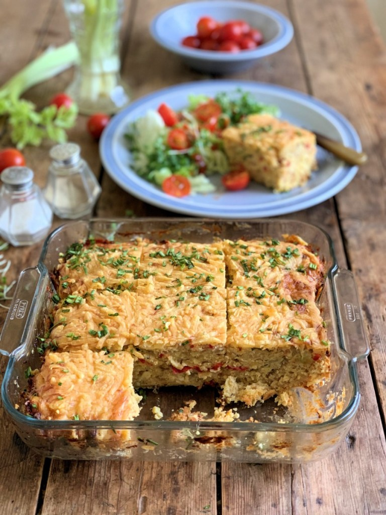 Scatter the rest of the grated cheese over the top of the mixture and bake for 25 to 50 minutes until it is firm, and the cheese has melted and is golden brown. Remove from the oven and allow to cool slightly before cutting into slices and serving warm with salad or seasonal vegetables. Can be served cold too.