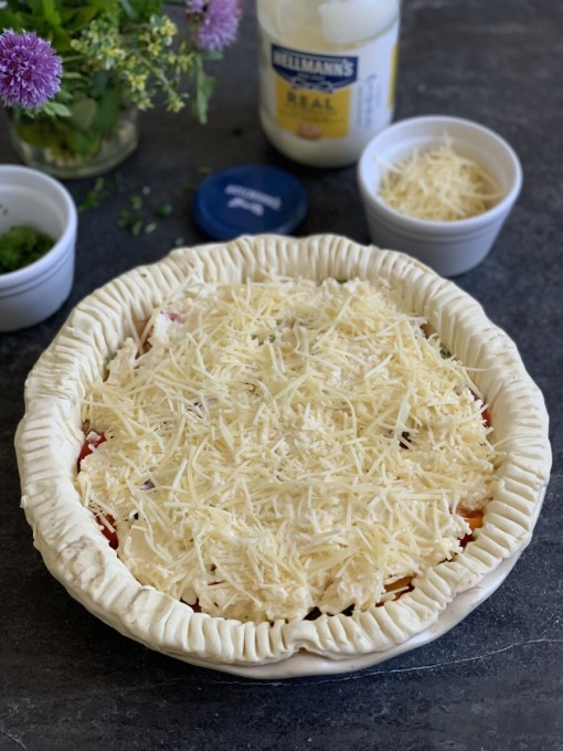 Mix half of the remaining Gruyere cheese with all of the Cheddar cheese and mayonnaise until you have a thick paste, and spoon the mixture over the tomatoes.