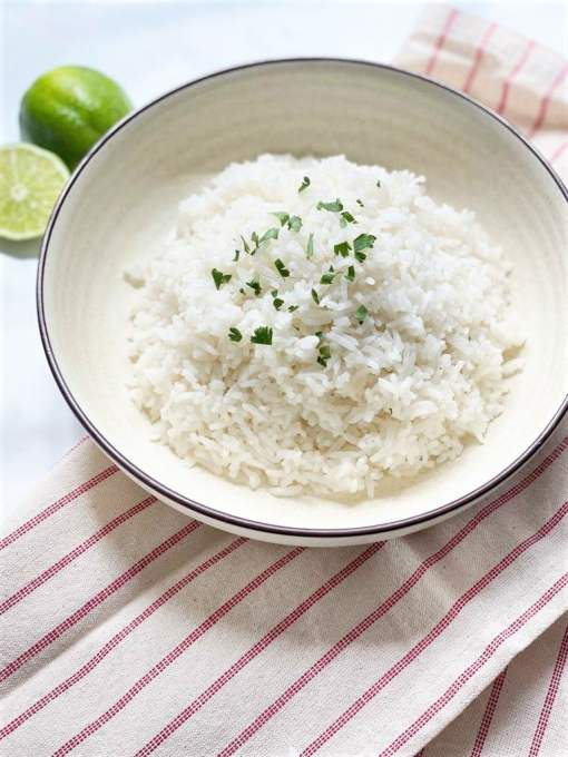Never quite sure how to cook rice? This recipe is for you. This easy Coconut Rice with Lime is a failsafe way to fluffy rice that's never mushy or undercooked. Delicately flavored with coconut milk and lime, this is a tried and tested side with cooking instructions for both the stovetop and a rice cooker.