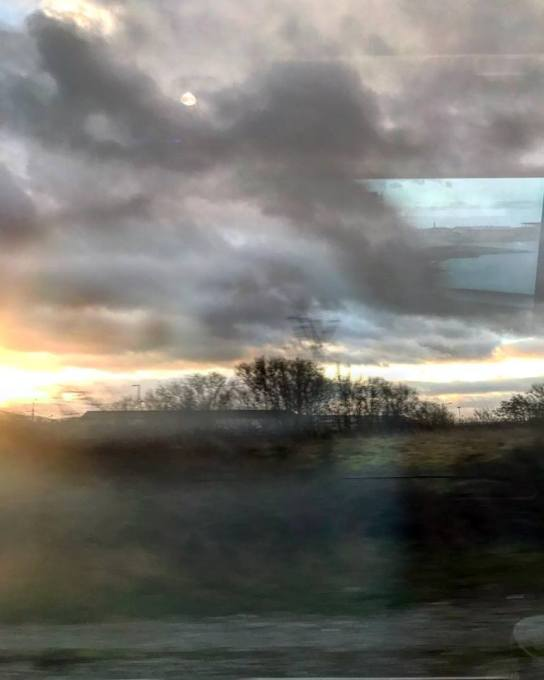 Window views on the 0720 train to London.....clickety clack, creaks and squeaks as I view the passing landscape from my comfy seat. Scudding clouds cling to horizons whilst the moon still shows its face behind the chimney stacked houses.
