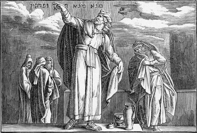 Daniel interpreting the writing on the wall Daniel 5:25-28