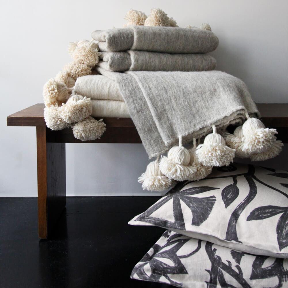 moroccan pom pom blankets solid natural white  laviva home