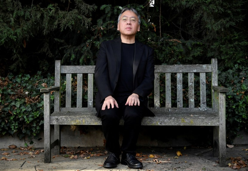 Author Kazuo Ishiguro poses for the media outside his home, following the announcement that he has won the Nobel Prize for Literature, in London, Britain October 5, 2017. REUTERS/Toby Melville     TPX IMAGES OF THE DAY