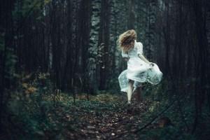 Girl running in the woods
