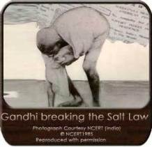 Gandhi breaks British salt laws