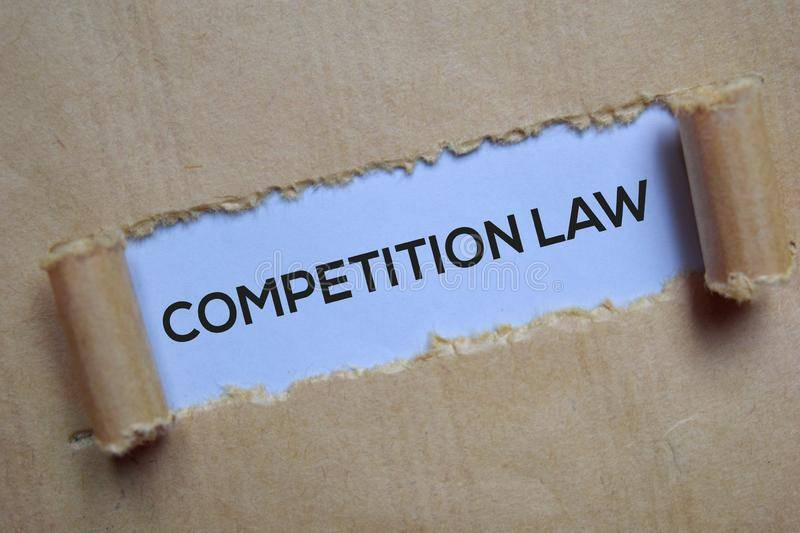 competition law text written torn paper 163992149 Merger and Amalgamation in Competition Law