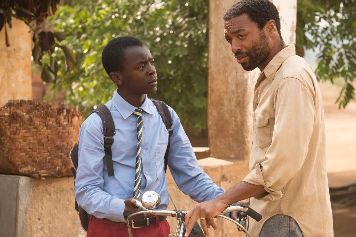 Chiwetel Ejiofor, right, with Maxwell Simba, stars in and directed The Boy Who Harnessed the Wind.; Credit: Netflix