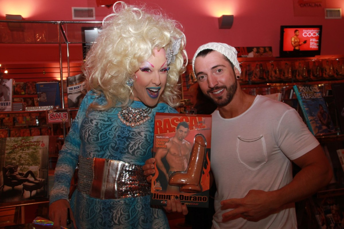 Chi Chi LaRue and Jimmy Durano show off the latest products.; Credit: Xbiz