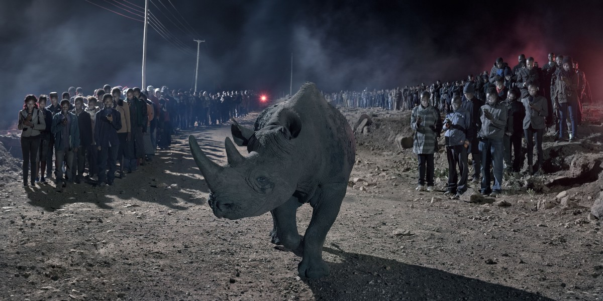 Nick Brandt, River of People With Blind Rhino (2018), archival pigment print; Credit: Courtesy of the artist and Fahey/Klein Gallery