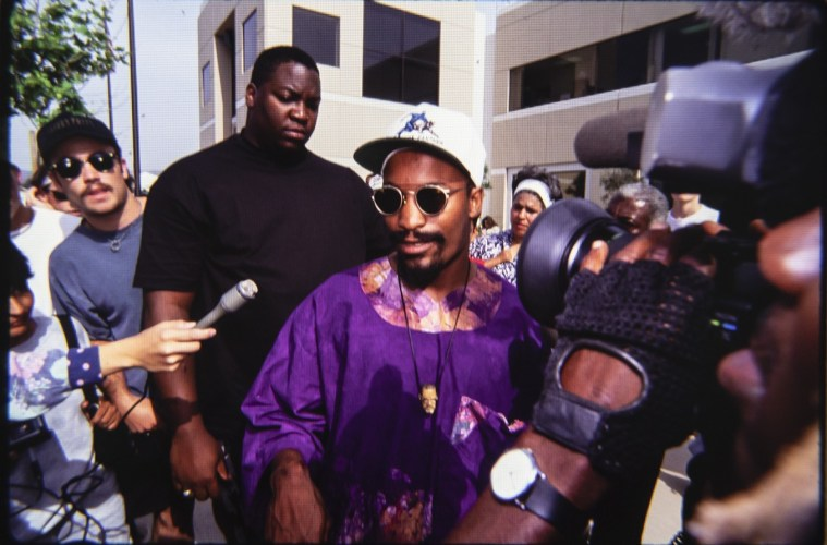 """L.A. Weekly photographer Ted Soqui captured this image of John Singleton 27 years ago in Simi Valley right after the """"not guilty"""" verdicts for the 4 LAPD officers charged in the beating of Rodney King came in and sparked the L.A. Riots. Singleton passed away on the same date — April 29 — this week.; Credit: Ted Soqui"""