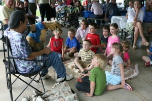 Children are entertained by a puppeteer at a family gathering