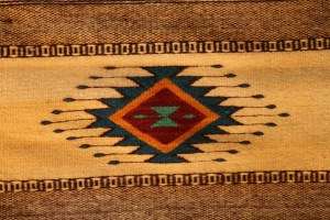 Traditional Mexican wool rug made by family tradition and from natural dyes
