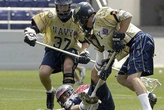 lacrosse two players battle for a loose ball