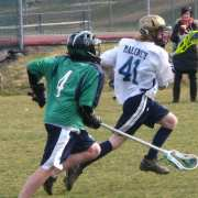 youth lacrosse defender out of position chasing