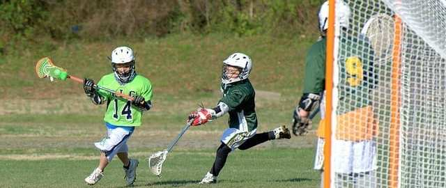 youth lacrosse righty sweep dodge into slot