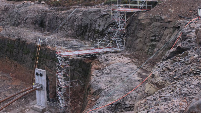Descent into the pit by Nayland Scaffold and Crane