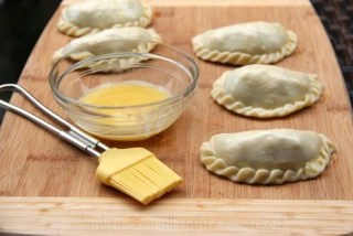 For a golden glow, brush the empanadas with egg wash before baking