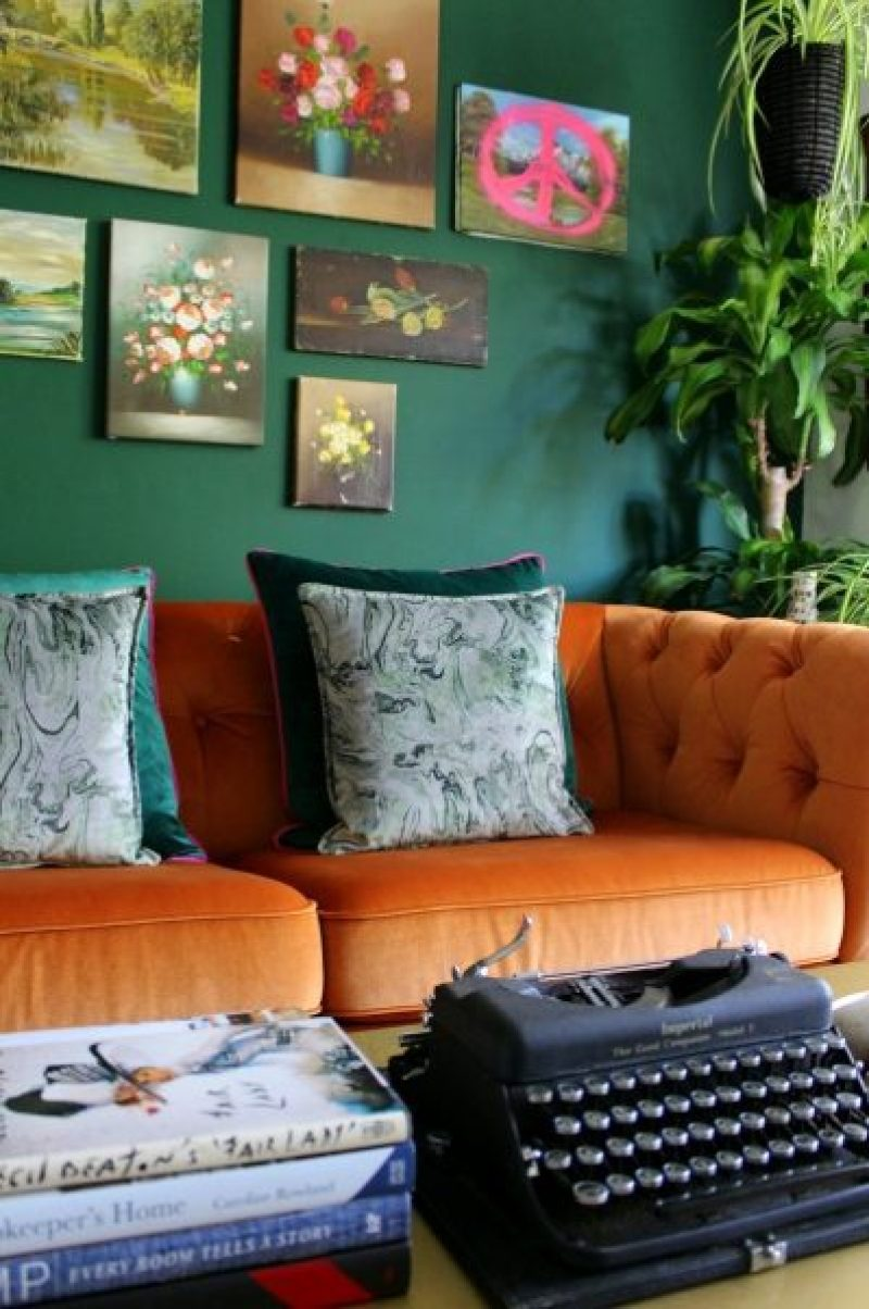 corner of room with plants and velvet sofa