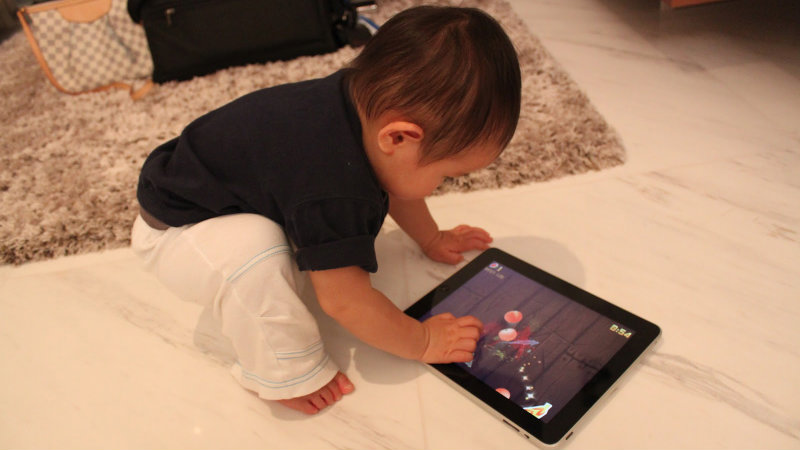 Baby geoff with ipad